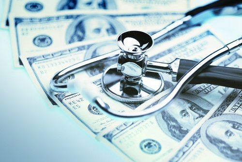Integrated Healthcare | Stethoscope on Top of Cash
