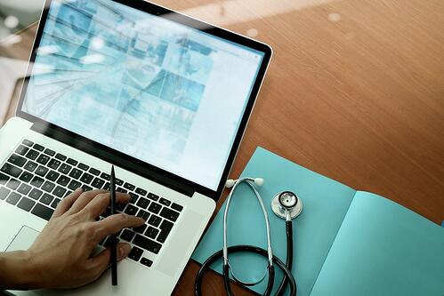 Integrated Healthcare | Stethoscope and Laptop